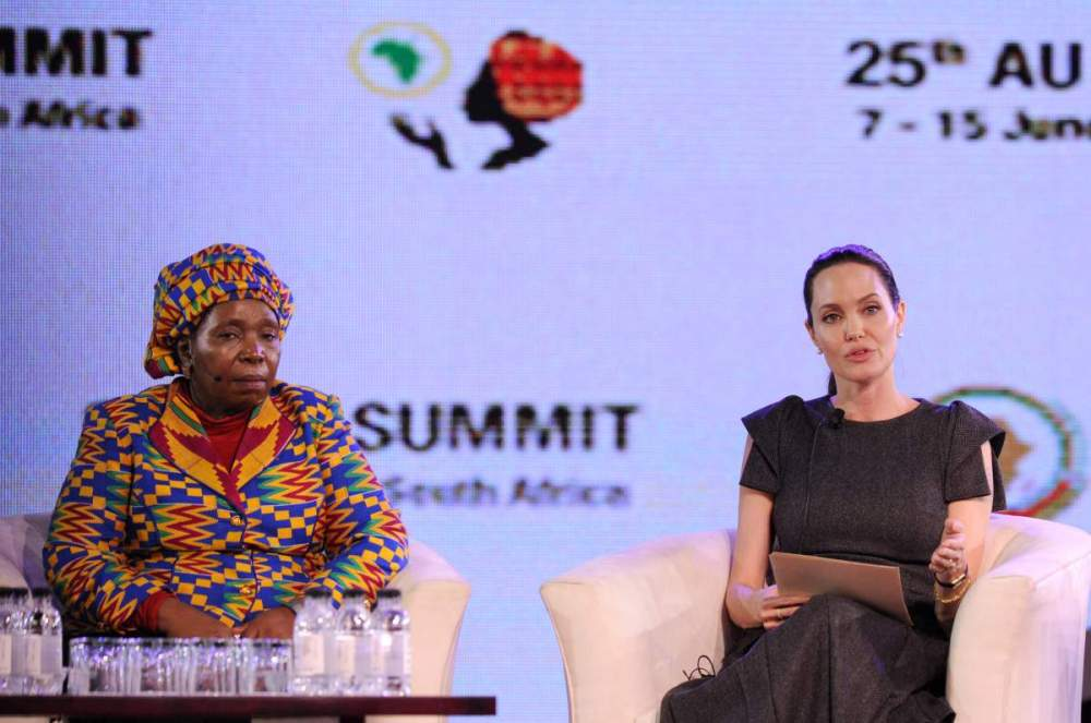 African Union Commssion Chairperson Nkosazana Dlamini-Zuma (L) and US actress and United Nations High Commissioner for Refugees (UNHCR) special envoy Angelina Jolie attend a panel discussion on Conflict related Gender Violence on June 12, 2015 during an African Union (AU) Summit session in Johannesburg. The 25th Ordinary Session of the African Union will be held ni Johannesburg from June 7-15 with the theme of women's empowerment. AFP PHOTO / GORDON HARNOLS        (Photo credit should read GORDON HARNOLS/AFP/Getty Images)