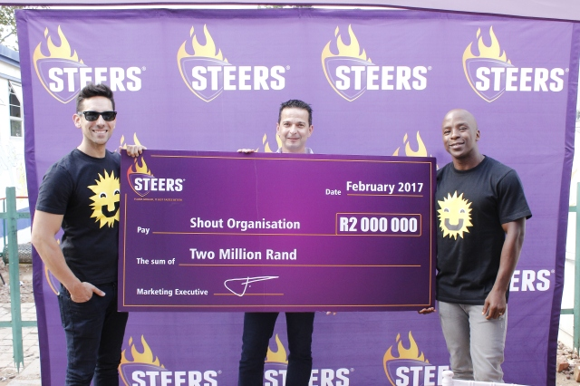 Danny K, Kabelo Mabalane and Steers Marketing Executive Adolf Fourie holding  the R2 million Check - Steers SHOUT Check Handover.JPG