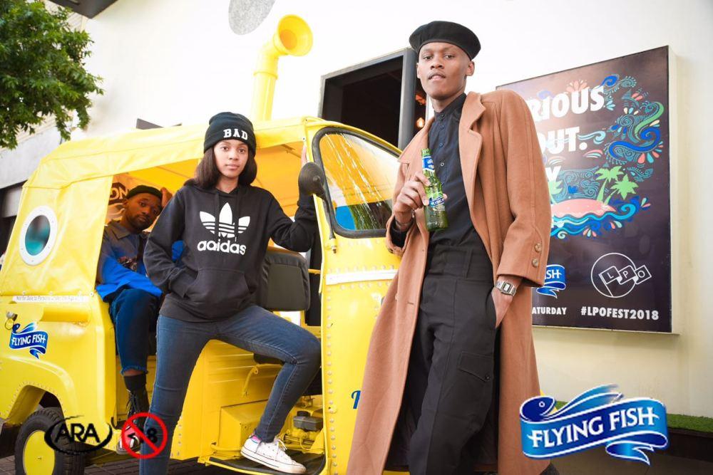LPO members striking a pose at the Tuk Tuk Photobooth - Flying Fish Save My Saturday Launch.jpeg